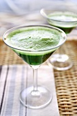 Green barley grass extract in a Martini glass