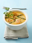 Red curry soup with salmon and asparagus