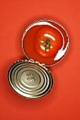 Fresh tomato in an opened tin