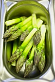 Green asparagus tips in a Gastronorm container