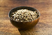 Green lentils in a small bowl