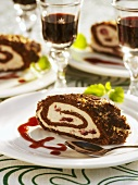 Cream-filled chocolate roll with red fruit sauce