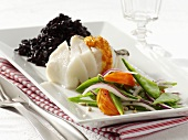 Cod fillet with black rice and vegetables