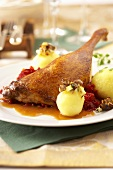 Roast goose leg with potato dumplings