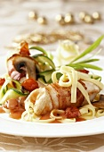 Chicken breast wrapped in bacon with ribbon pasta & vegetables