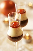 Layered chocolate & vanilla dessert with liqueur cherries