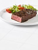 Beef steak with salad