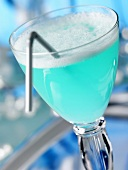 Blue cocktail with straw