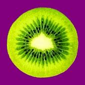 A slice of kiwi fruit with purple background