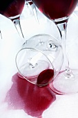 A spilt glass of red wine
