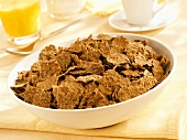 Whole wheat cereal flakes in a dish