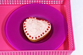 Heart-shaped cake on pink tray