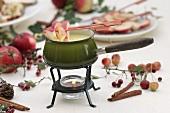 White chocolate fondue with cinnamon apples