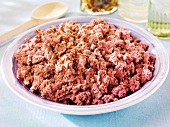 Crumbled corned beef in a dish