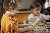 Two children baking biscuits