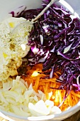 Ingredients for red cabbage salad in a bowl