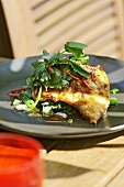 Fried fish fillet with herb salad