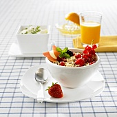 Muesli with fruit, orange juice and herb quark