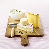 Hard cheese, soft cheese & fresh cheese on a wooden board