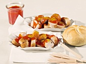 Two portions of currywurst (sausage with curry powder) in paper dishes