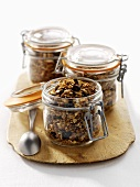 Muesli in three storage jars