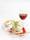 Rum and raisin ice cream with strawberry sauce