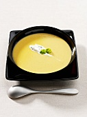 Vegetable cream soup with herb soft cheese