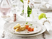 Spring rolls and salmon cubes with horseradish cream