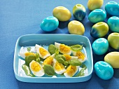 Hard-boiled eggs with olive oil and basil