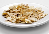 Toasted flaked almonds on a plate