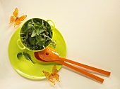 Assorted salad leaves in a small bowl