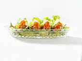 Salmon tartare with trout caviar in lettuce leaves