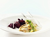 Fried herring fillets with beetroot and onion sauce