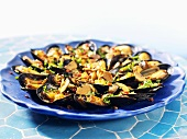 Mussels with diced bacon and parsley