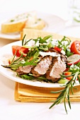 Rosemary steak on rocket salad