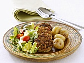 Chicken burgers with boiled potatoes and salad