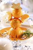 Christmas decoration: little man made from oranges