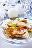 Turkey steaks with slices of orange