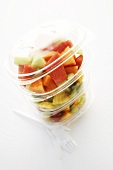 Mixed fruit salad in plastic containers