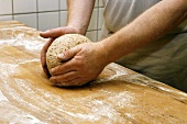 Shaping a loaf of bread