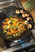 Vegetables in a wok with prawns