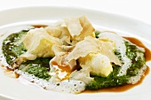 Ricotta dumplings on spinach with white truffle