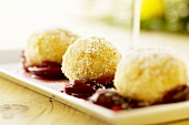 Curd cheese dumplings with apple and damson compote