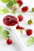 Wild strawberry jam on a spoon