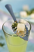 Absinthe with sugar cube on a silver spoon