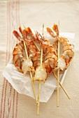 Skewered prawns on greaseproof paper