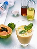 Fruit cocktail with papaya and basil