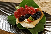 Filo pastry shell filled with mascarpone cream and berries