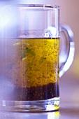 Mustard dressing in a glass jug