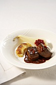 Venison medallions in red wine, chocolate and chilli sauce